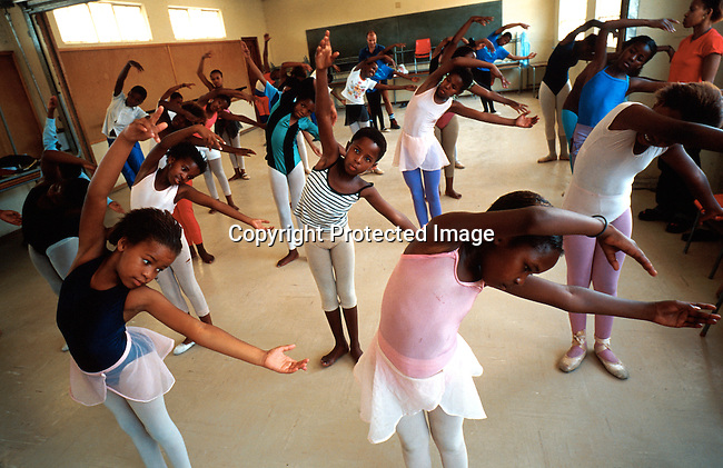 Dance students warming up before a ballet class on January 28, 2000 in Yomelela school in Khayelitsha outside Cape Town, South Africa. The program was started by the Cape Town City Ballet and has helped a lot of students to achieve a better education and something meaningful to do after school..Photo: Per-Anders Pettersson/Agentur Focus
