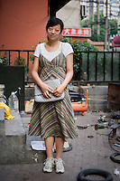 "Zhoumanli, a culture representative, age 25, poses for a portrait in Nanjing. Response to 'What does China mean to you?': '""Home."" China is a country composed of over 5000 years of history and culture. None of the other famous countries of the world can compare to it's lengthy history and culture.  '  Response to 'What is China's role in the future?': 'Cultured country. Civilized country. A country with etiquette.'"