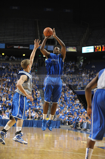 Junior Darius Miller pulls up a jump shot during the UK mens basketball Blue/White scrimmage. Photo by Mike Weaver | Staff