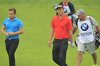 Marcel Siem (GER) and Tyrrell Hatton (ENG) walk to the 17th green during Friday's Round 2 of the 2014 BMW Masters held at Lake Malaren, Shanghai, China 31st October 2014.<br /> Picture: Eoin Clarke www.golffile.ie