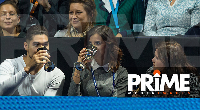 Gymnast Louis Smith drinks champagne with girlfriend Lucy Mecklenburgh (centre) (TOWIE) during the Barclays ATP World Tour Finals Semi Final 1 match between RAFAEL NADAL and NOVAK DJOKOVIC at the O2, London, England on 21 November 2015. Photo by Andy Rowland.