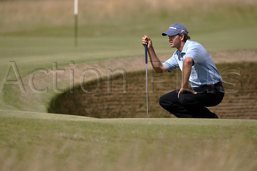 15 July 2005: South African golfer Retief Goosen (RSA) studies the Green during the second round. Goosen shot a 1 over par 73 to be 3 under par in The Open Championship on The Old Course at St Andrews, Scotland. Photo: Glyn Kirk/Actionplus....050715 golf major british