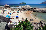 BRAZIL, Rio de Janiero, several beach goers enjoy a warm day at Grumari Beach