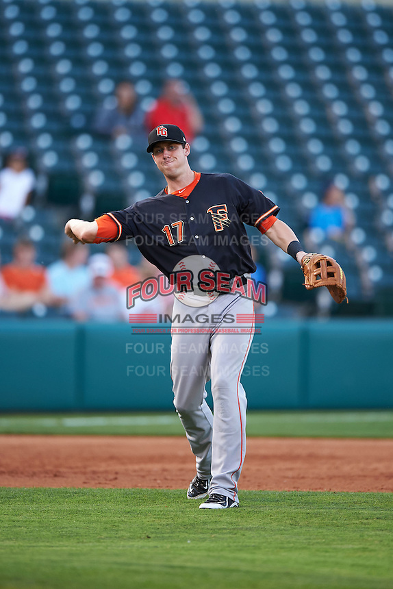 Fresno Grizzles third baseman Matt Duffy (17) warmup throw to first during a game against the Oklahoma City Dodgers on June 1, 2015 at Chickasaw Bricktown Ballpark in Oklahoma City, Oklahoma.  Fresno defeated Oklahoma City 14-1.  (Mike Janes/Four Seam Images)
