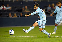 Sporting KC midfielder Omar Bravo (99) has a shot on goal... Sporting Kansas City played Chivas Guadalajara to a 2-2 tie at LIVESTRONG Sporting Park, Kansas City, Kansas in an international friendly.