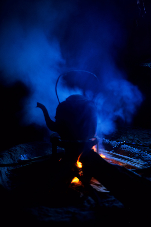 Tea boiling inside a traditional house, Abachkou, High Atlas, Morocco, 2002