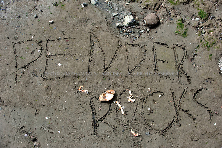 8/26/2009--Pender Island, British Columbia, Canada..Sand graffiti on the beach at the Pender Islands Museum  and Roesland...©2009 Stuart Isett. All rights reserved.