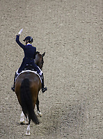 OMAHA, NEBRASKA - MAR 30: Laura Graves waves to the crowd after her ride during the FEI World Cup Dressage Final I at the CenturyLink Center on March 30, 2017 in Omaha, Nebraska. (Photo by Taylor Pence/Eclipse Sportswire/Getty Images)
