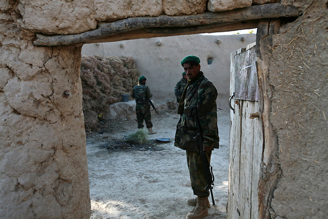 Afghan troops search a compound for Taliban weapons and other supplies in the Shah Joy district of southern Afghanistan's Zabul province. Oct. 25, 2010. DREW BROWN/STARS AND STRIPES