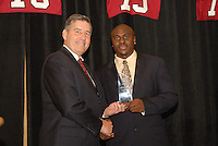 14 January 2007: Bob Bowlsby presents an award to Wopamo Osaisai at the annual football banquet at McCaw Hall in Stanford, CA.