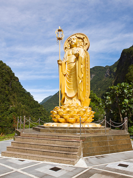 """Ti Tsang """"Earth Store"""" (Ksitigarbha) Statue, at Hsiang-te Temple, in the Taroko Gorge. Taiwan. .Kitigarbha (known in Chinese as Dizang in Japanese as Jiz and in Vietnamese as a Tng) is a popular Mahayana Buddhist Bodhisattva, usually depicted as a Buddhist monk in the Orient. The name Dizang may be translated as """"Earth Treasury"""", """"Earth Store"""", """"Earth Matrix"""", or """"Earth Womb."""" It is derived from shortening of Chinese script reading of Sanskrit word ksiti (earth; ) and garbha (womb, matrix)..Kitigarbha is known for his vow not to achieve Buddhahood until all hells are emptied; therefore, he is regarded as the bodhisattva of hell beings. His famous vow, recited by many Buddhists, is, """"Not until the hells are emptied will I become a Buddha; Not until all beings are saved will I certify to Bodhi."""".Usually depicted as a monk with a nimbus around his shaved head, he carries a staff to force open the gates of hell and a wish-fulfilling jewel to light up the darkness."""