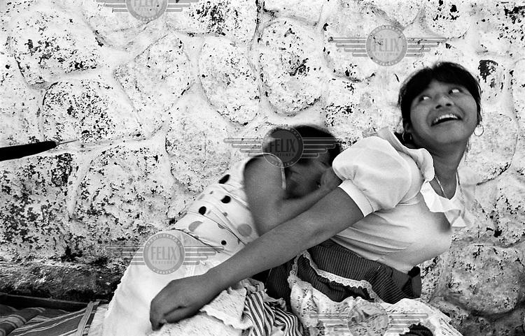 Two women play around near the Tapachula market.