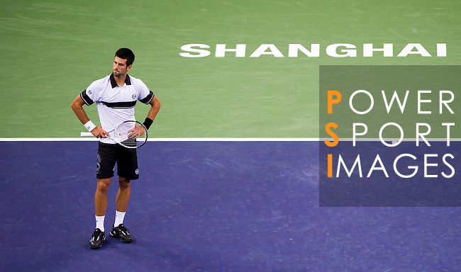 SHANGHAI, CHINA - OCTOBER 14:  Novak Djokovic of Serbia reacts after loosing a point against Richard Gasquet of France during day four of the 2010 Shanghai Rolex Masters at the Shanghai Qi Zhong Tennis Center on October 14, 2010 in Shanghai, China.  (Photo by Victor Fraile/The Power of Sport Images) *** Local Caption *** Novak Djokovic