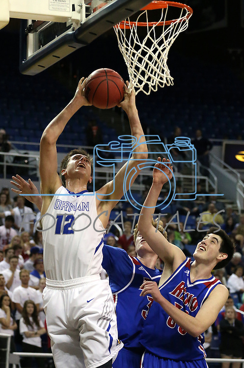 Bishop Gorman's Zach Collins shoots over Reno defenders David Kyle, center, and Michael Heydon, right, during the NIAA Division I state basketball tournament in Reno, Nev. on Thursday, Feb. 25, 2016. Gorman won 70-39. Cathleen Allison/Las Vegas Review-Journal