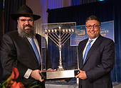 Makan Delrahim, Assistant Attorney General (Anti-Trust), United States Department of Justice, right, accepts the 2019 Lamplighter Special Friend Award from Rabbi Levi Shemtov, Executive Vice President of the American Friends of Lubavitch (Chabad), left, during a gala dinner at the Organization of American States in Washington, DC on Tuesday, June 18, 2019.<br /> Credit: Ron Sachs / CNP