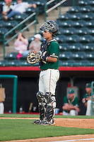 Greensboro Grasshoppers catcher Arturo Rodriguez (54) on defense against the Hickory Crawdads at L.P. Frans Stadium on May 6, 2015 in Hickory, North Carolina.  The Crawdads defeated the Grasshoppers 1-0.  (Brian Westerholt/Four Seam Images)