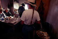 Rancher Heidi Redd makes a breakfast for ranch hands in the bunkhouse at Beef Basin. Red was moving her cattle from the Dugout ranch to higher ground and more forage and water for the winter.  Many Western ranchers depend heavily on BLM allotments, where grazing fees remain far lower than on state or private lands.