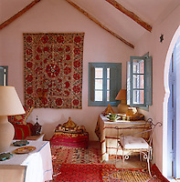 Inspired by travels in Morocco and India, the interior of the poolhouse is an exotic combination of colours and textiles