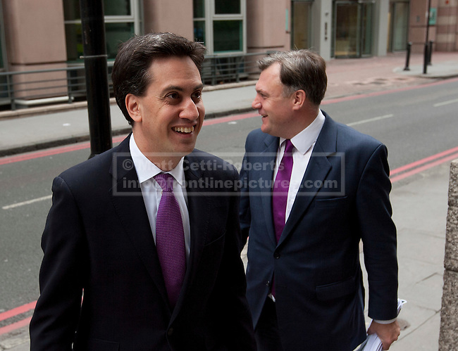 08/07/2012. LONDON, UK. Labour Leader, Ed Miliband, (L) and the shadow chancellor, Ed Balls, arrive to give a talk by the Labour Leader on responsible banking at the Cooperative Bank in East London today (09/07/12). Photo credit: Matt Cetti-Roberts