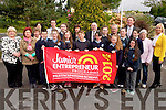 Education Minister Ruari Quinn wlth parents, teachers and pupils at Kilcummin National School last week to raise their Junior Entrepreneur Flag (JEP).