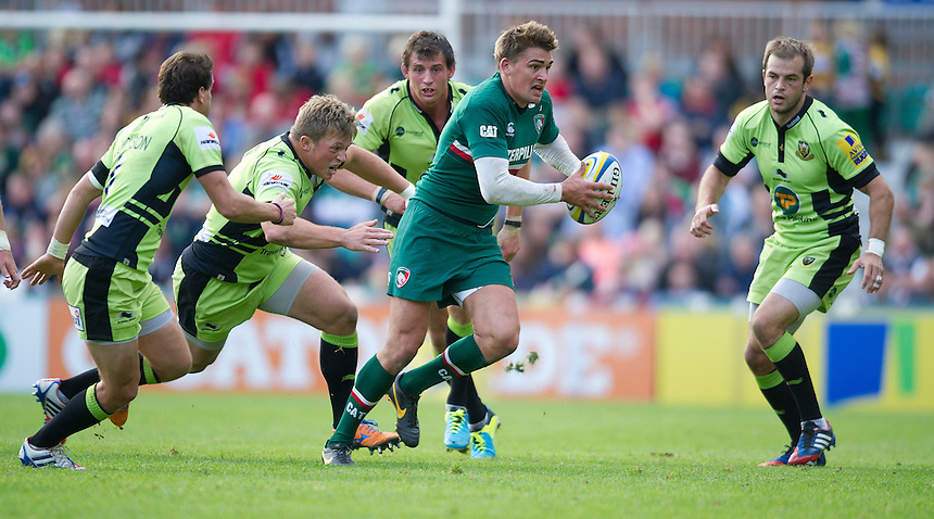 Leicester Tigers' Toby Flood tries to get away from Northampton Saints' Alex Waller <br /> <br /> Photo by Stephen White/CameraSport<br /> <br /> Rugby Union - Aviva Premiership - Leicester Tigers v Northampton Saints - Saturday 5th October 2013 - Welford Road - Leicester<br /> <br /> &copy; CameraSport - 43 Linden Ave. Countesthorpe. Leicester. England. LE8 5PG - Tel: +44 (0) 116 277 4147 - admin@camerasport.com - www.camerasport.com