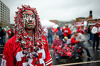 Rex Staley is adorned in face paint and a weaved scarlet and gray handmade wig, as he was watching the Ohio State vs Michigan State game at the River Jam, at River Watch Tower, Saturday, October 1, 2011. (Dispatch photo by Ty Wright