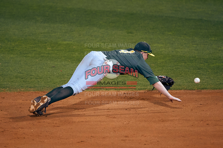 Siena Saints second baseman Jordan Bishop (4) makes a diving attempt during a game against the Stetson Hatters on February 23, 2016 at Melching Field at Conrad Park in DeLand, Florida.  Stetson defeated Siena 5-3.  (Mike Janes/Four Seam Images)