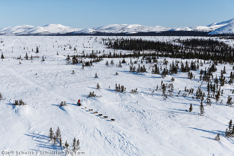 Ray Redington Jr. runs on the trail over the Kaltag - Unalakleet Portage near Tripod Flats on Saturday March 8, during the Iditarod Sled Dog Race 2014.<br /> <br /> PHOTO (c) BY JEFF SCHULTZ/IditarodPhotos.com -- REPRODUCTION PROHIBITED WITHOUT PERMISSION