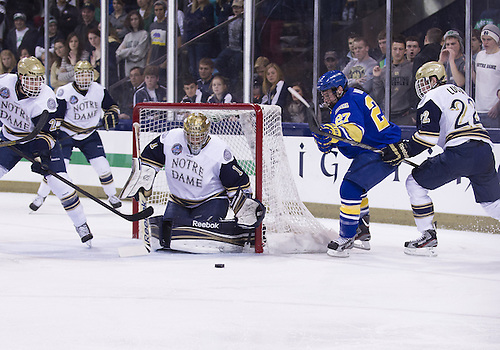January 18, 2013:  Notre Dame goaltender Steven Summerhays (1) makes save on shot by Alaska forward Tyler Morley (27) during NCAA Hockey game action between the Notre Dame Fighting Irish and the Alaska Nanooks at Compton Family Ice Arena in South Bend, Indiana.  Alaska defeated Notre Dame 5-4.