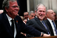 Former President George W. Bush smiles with his brother Jeb Bush at the State Funeral for their father, former President George H.W. Bush, at the National Cathedral, Wednesday, Dec. 5, 2018, in Washington. <br /> CAP/MPI/RS<br /> &copy;RS/MPI/Capital Pictures