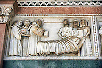 Late medieval relief sculpture of a scene of the life of St Martin on the Facade of the Cattedrale di San Martino,  Duomo of Lucca, Tunscany, Italy,