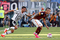 Calcio, Serie A: Roma vs Juventus. Roma, stadio Olimpico, 30 agosto 2015.<br /> Roma&rsquo;s Radja Nainggolan, right, is chased by Juventus&rsquo; Stefano Sturaro during the Italian Serie A football match between Roma and Juventus at Rome's Olympic stadium, 30 August 2015.<br /> UPDATE IMAGES PRESS/Riccardo De Luca