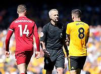 Wolverhampton Wanderers' Ruben Neves remonstrates with Referee Martin Atkinson as Liverpool's Jordan Henderson looks on<br /> <br /> Photographer Rich Linley/CameraSport<br /> <br /> The Premier League - Liverpool v Wolverhampton Wanderers - Sunday 12th May 2019 - Anfield - Liverpool<br /> <br /> World Copyright © 2019 CameraSport. All rights reserved. 43 Linden Ave. Countesthorpe. Leicester. England. LE8 5PG - Tel: +44 (0) 116 277 4147 - admin@camerasport.com - www.camerasport.com