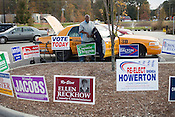 Mohamed Eltayeb, Cab #30, of Durham's Best Cab Company, helps an elderly voter to the poll at South Durham Library, Durham, North Carolina Election Day, November 6, 2012. .