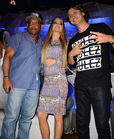 BOCA RATON, FL - OCTOBER 23: Floyd Raglin, Carmen Electra and Jonathan Cheban attends Fright Night by Berman and Berman Law held at the Blue Martini on October 23, 2014 in Boca Raton, Florida. Credit: MPI10 / MediaPunch