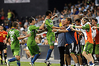 Seattle players celebrate their game winning goal on the sideline with the coaches and layers from the bench... Sporting Kansas City were defeated 1-2 by Seattle Sounders at LIVESTRONG Sporting Park, Kansas City, Kansas.