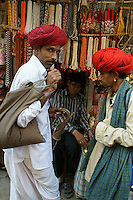 man with trumpet while camel fair in the streets holy city Pushkar
