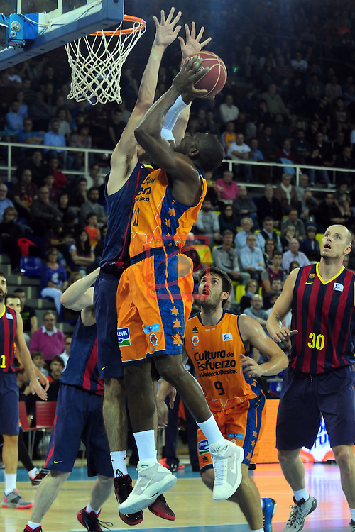 League ACB-Endesa 2014/2015 - Game: 07.<br /> FC Barcelona vs Valencia Basket Club: 76-57.<br /> Alex Abrines vs Romain Sato.