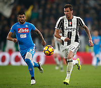 Calcio, Serie A: Juventus Stadium. Torino, Juventus Stadium, 29 ottobre 2016.<br /> Juventus&rsquo; Mario Mandzukic, right, is chased by Napoli's Elseid Hysaj during the Italian Serie A football match between Juventus and Napoli at Turin's Juventus Stadium, 29 October 2016. Juventus won 2-1.<br /> UPDATE IMAGES PRESS/Isabella Bonotto