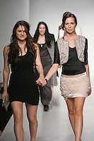 Senior fashion designer Megan Carlee, walks runway with model, at the close of the Pratt 2011 fashion show.