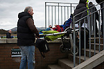 A man carrying a child in a pram up a stairway before Edinburgh University took on Selkirk in a Scottish Lowland League match at Peffermill, Edinburgh in a game the hosts won 3-2. The match was one of six attended by members of GroundhopUK over the weekend to accommodate groundhoppers, fans who attempt to visit as many football venues as possible. Around 100 fans in two coaches from England participated in the 2016 Lowland League Groundhop and they were joined by other individuals from across the UK which helped boost crowds at the six featured matches.