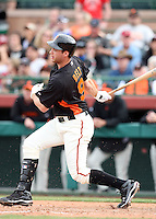 Brandon Belt #9 of the San Francisco Giants bats against the Arizona Diamondbacks in the first spring training game of the season at Scottsdale Stadium on February 25, 2011  in Scottsdale, Arizona. .Photo by:  Bill Mitchell/Four Seam Images.