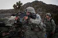 US Army Soldiers from Viper Company 126, 2nd Platoon, patrol near Restrepo Firebase in the restive Korengal Valley. The patrol provided an overwatch for 1st Platoon who came under fire as they built a new observation post. Restrepo, a remote outpost, is known as one of the most violent places in Afghanistan. Located in the Korengal Valley it comes under fire on a daily basis from Anti-Afghan Forces in the local villages and mountains.