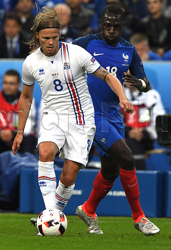 03.07.2016. St Denis, Paris, France.  France's Moussa Sissoko is shielded by Iceland's Birkir Bjarnason during the UEFA EURO 2016 quarter final soccer match between France and Iceland at the Stade de France in Saint-Denis, France, 03 July 2016.