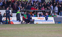 The Accrington bench and Newport County manager Warren Feeney (left) during the Sky Bet League 2 match between Newport County and Accrington Stanley at Rodney Parade, Newport, Wales on 28 March 2016. Photo by Mark  Hawkins.