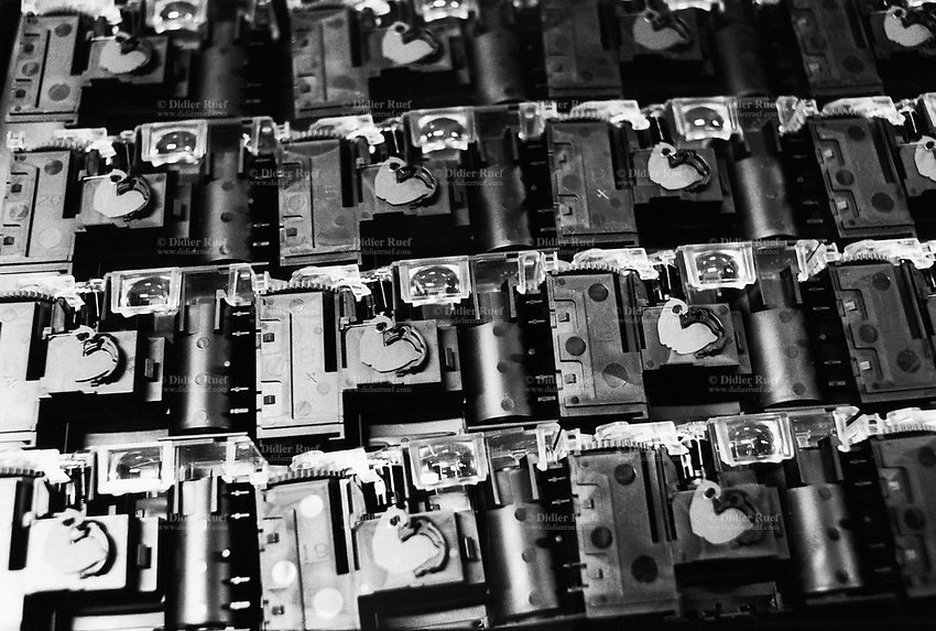 """France. Saône-et-Loire department. Chalon-sur-Saône. Kodak factory. Camera recycling.The """"ready to take pictures"""" camera is a small camera commonly described as disposable but in fact assembled for customers to return it after use. After being dismantled, verified and meticulously cleaned, some pieces are reused, other recycled (86%). The recycled parts are the front, film, upper and rear part, lens. The plastics parts are torn, melted, recasted and then reassembled.  Eastman Kodak Company. Chalon-sur-Saône is located in the south of the Burgundy region. © 1996 Didier Ruef ."""