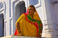 Woman outside a house, Osian, Rajasthan, India
