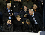 Richard Gough gets a welcoming handshake from Paul Murray as he takes his seat in the Rangers directors box