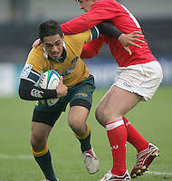 Australia winger Alfi Mafi is tackled by Welsh centre Rhys Williams during the clash 3rd/4th place clash at Ravenhill, Belfast. Result Australia 25 Wales 21.