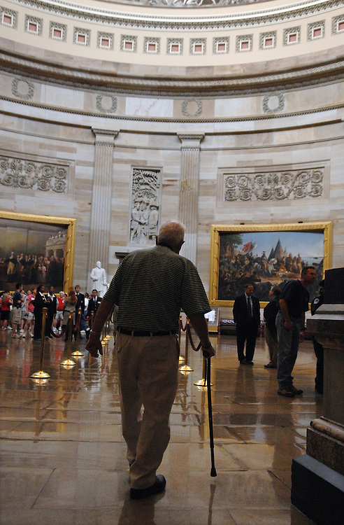 Daniel Callan, grandfather of Officer Joe Corr, New Hartford, N.Y. Police Department, who was killed in the line of duty 2/27/06, walks into the rotunda during a Capitol tour by Capitol Police Officer Kathleen McBride.